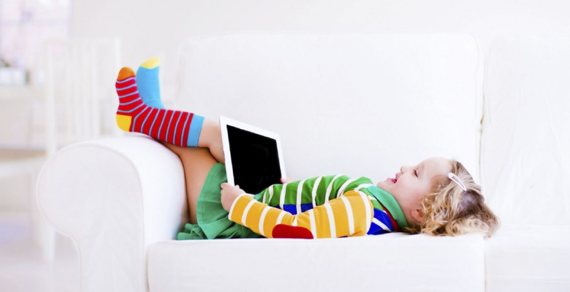Ipad Girl on Couch iStock