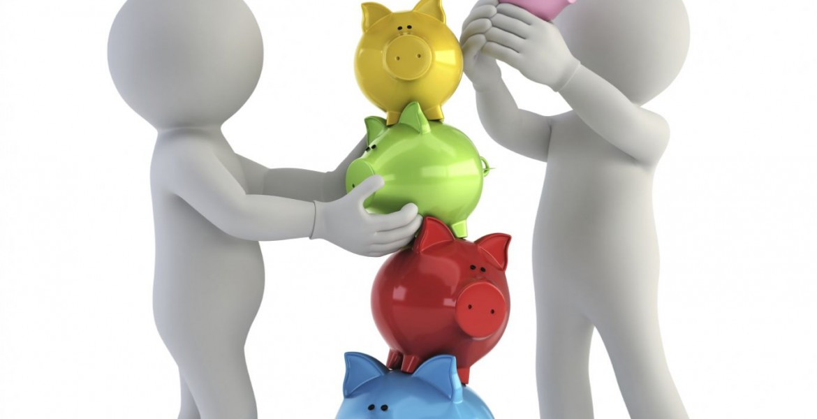 People stacking piggy banks